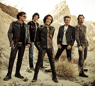 Photo of the band Journey in the desert.